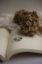 wedding ring on book for valentine's day