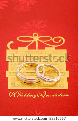 stock photo wedding ring on red wedding card with chinese character