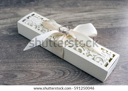 Wedding ring on wedding invitation. Wedding invitation. Box. Wedding    #591250046