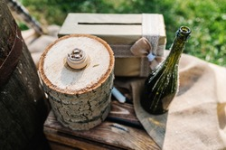 Wedding ring on wooden stump. Engagement. Wedding decor. Decorations against the background of wooden box.