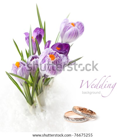 wedding rings and flower bouquet
