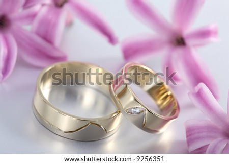 stock photo Wedding rings and flowers picture of wedding rings and flowers