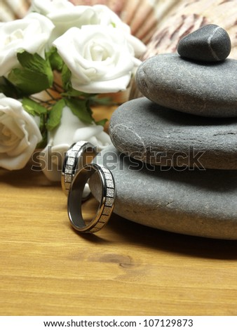 Wedding rings and pebble stones