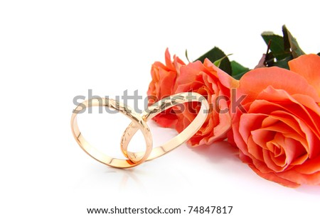 wedding rings and roses on white with space for writing (wedding invitation card )