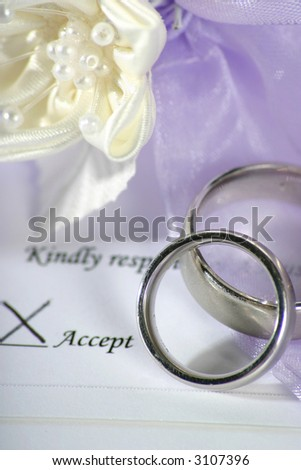 on a wedding invitation acceptance with white flower for decoration