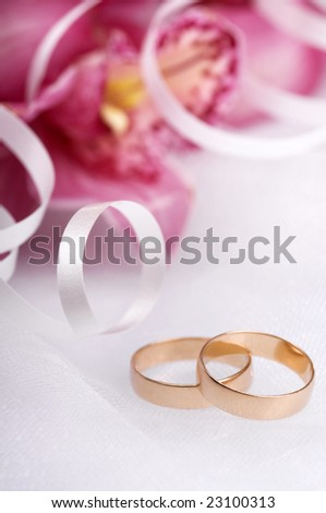 stock photo wedding rings close up with flowers