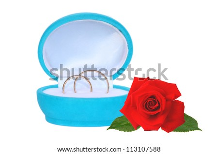 wedding rings in blue gift box and red rose isolated on white