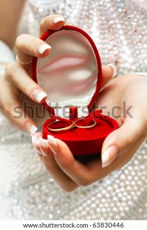Wedding rings in bride hands