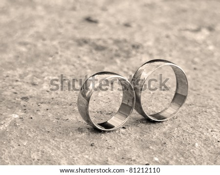 Wedding rings in infinity sign. Sepia style. - stock photo