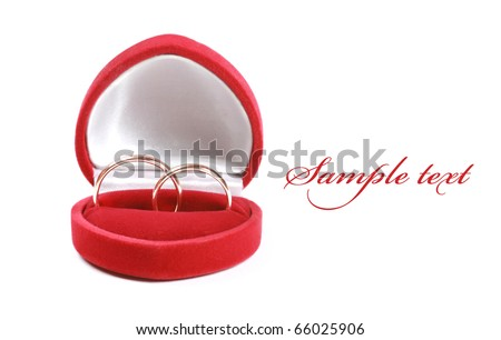 Wedding rings in red box isolated over white