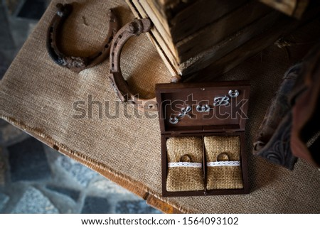 wedding rings in rustical style box in the barn - vintage