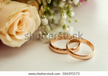 wedding rings lie on a beautiful bouquet as bridal accessories Stock photo ©