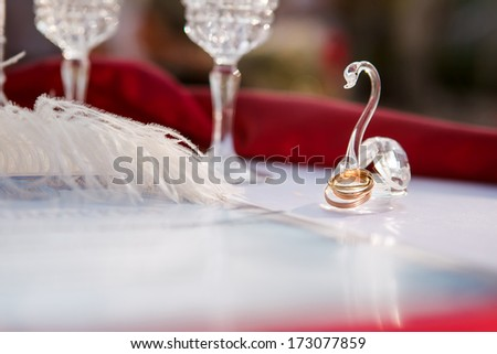 wedding rings newlyweds on the table before the wedding ceremony, closeup