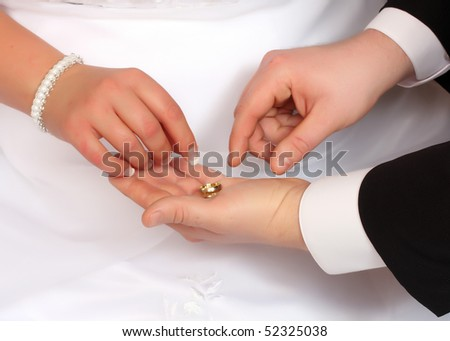 Wedding rings on a men's palm. Conceptual image.