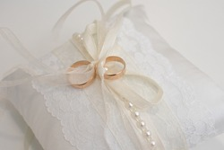 wedding rings on a pillow