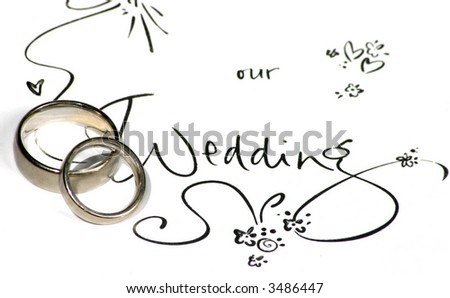 "wedding rings on a sign saying ""our wedding"""