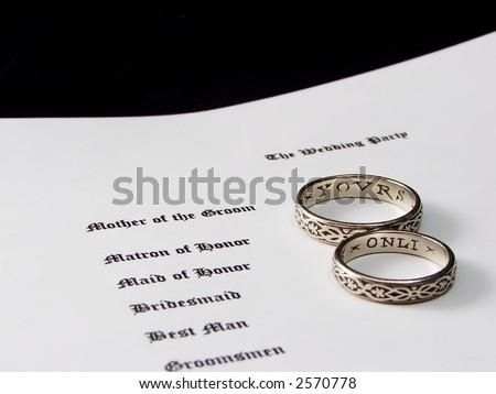 stock photo wedding rings on a wedding program