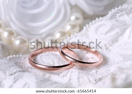 stock photo Wedding rings on lace background