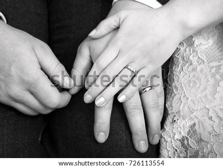 Wedding rings on newlywed bride and groom holding hands together #726113554