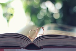 Wedding rings on open book