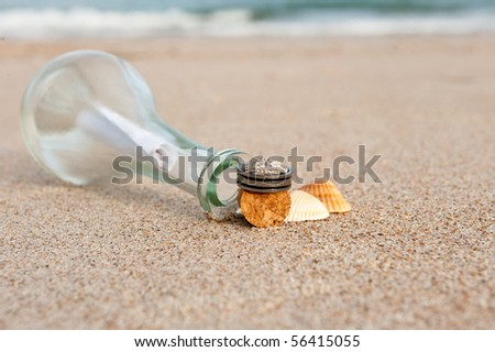 wedding rings on the beach with message