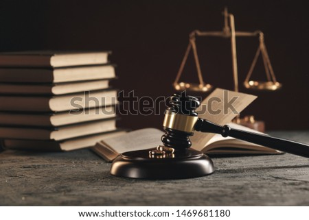 Wedding rings on the figure of a broken heart from a tree, hammer of a judge on a wooden background. Divorce divorce proceedings #1469681180