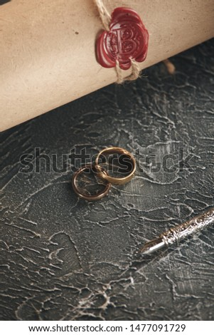 Wedding rings on the figure of a broken heart from a tree, hammer of a judge on a wooden background. Divorce divorce proceedings #1477091729