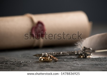 Wedding rings on the figure of a broken heart from a tree, hammer of a judge on a wooden background. Divorce divorce proceedings #1478836925