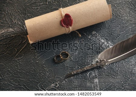Wedding rings on the figure of a broken heart from a tree, hammer of a judge on a wooden background. Divorce divorce proceedings #1482053549
