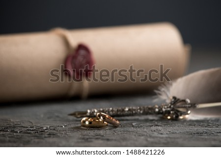 Wedding rings on the figure of a broken heart from a tree, hammer of a judge on a wooden background. Divorce divorce proceedings #1488421226