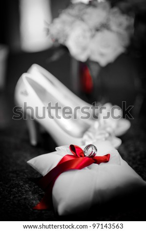 Wedding rings on the pillow and shoes