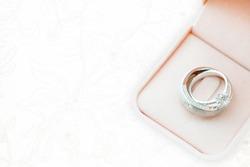 wedding rings on wedding dress, texture