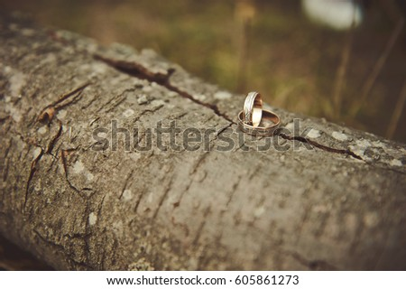 Wedding rings on wooden background.  #605861273