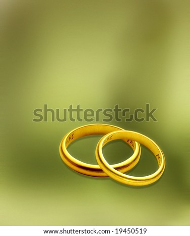 stock photo wedding rings over green background