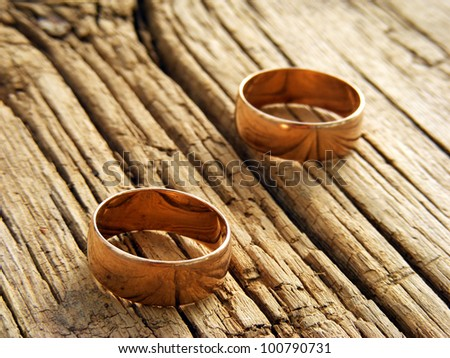 Wedding rings over wooden surface