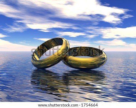 Wedding Rings Suspended On A Calm Ocean With a Sky Backdrop