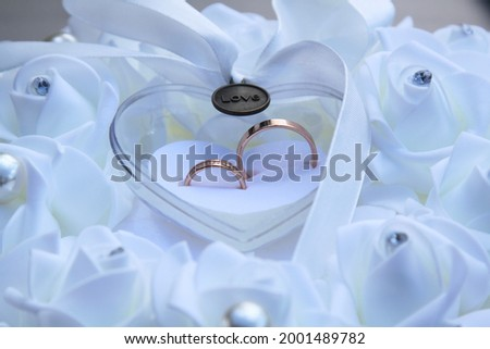 Photo of Wedding rings symbol love family. High quality photo. Selective focus