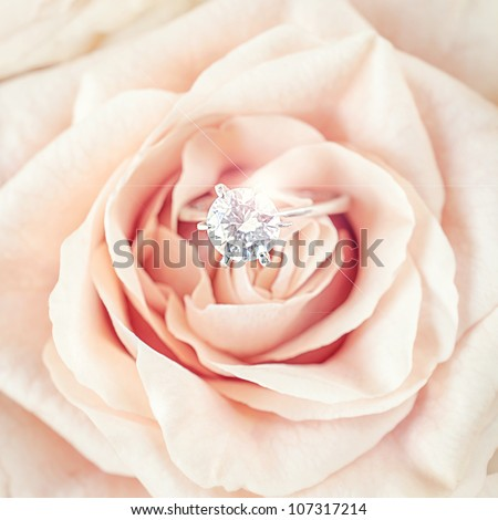 wedding rings with pastel pink rose