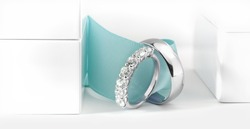 Wedding Rings with Ring Boxes and Green Ribbon