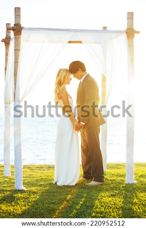 Wedding. Romantic Bride and Groom in Love on Wedding Day.