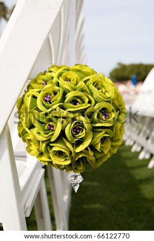 Wedding seats with green bouquet of flowers