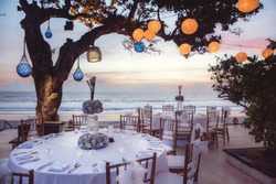 Wedding set up, party or romantic dinner on the beach with beautiful sunset view