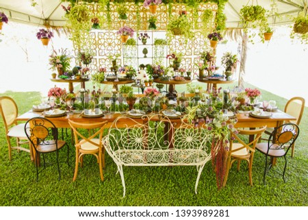 Wedding Setup. Banquet with table and chairs and cake tables with sweet. Decoration, flowers, ware, glass