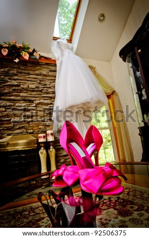 Wedding shoes and dress on the background