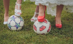 wedding shoes bride and her bridesmaids on a soccer ball