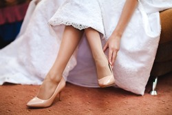 Wedding shoes on the bride's leg