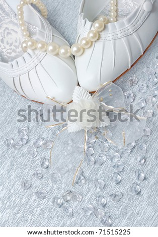 stock photo wedding shoes with pearls and crystals on silver background