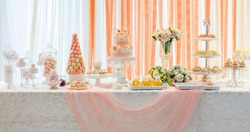 wedding sweet dessert Fondant Cake and  Macarons  gift table in