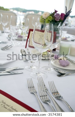 Wedding table arrangement with flowers and seating list - stock photo
