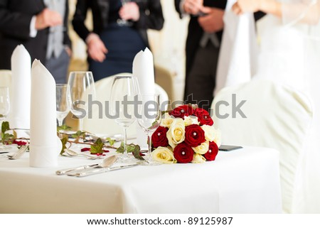 Wedding table at a wedding feast decorated with flowers